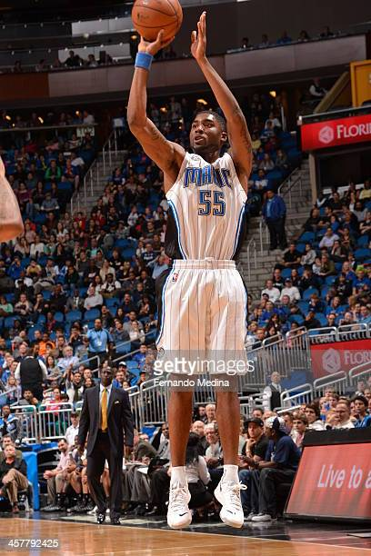 Twaun Moore of the Orlando Magic shoots a three pointer against the Utah Jazz during the game on December 18 2013 at Amway Center in Orlando Florida...