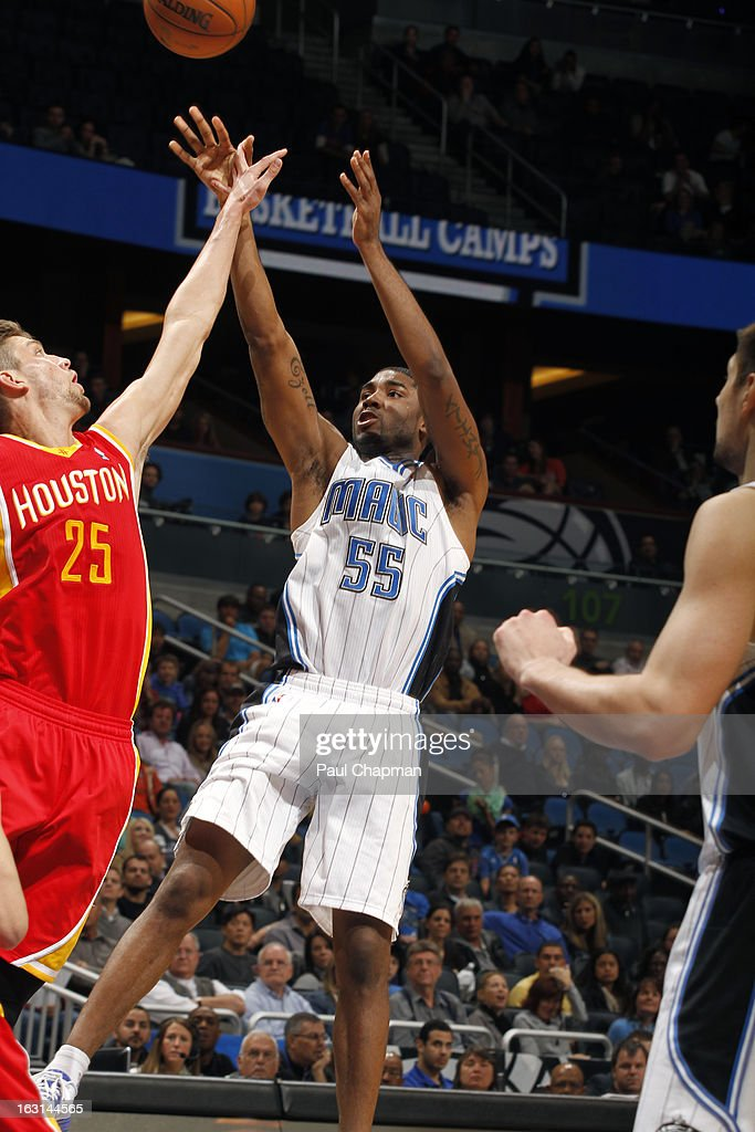 E'Twaun Moore #55 of the Orlando Magic takes a shot against the Houston Rockets on March 1, 2013 at Amway Center in Orlando, Florida.