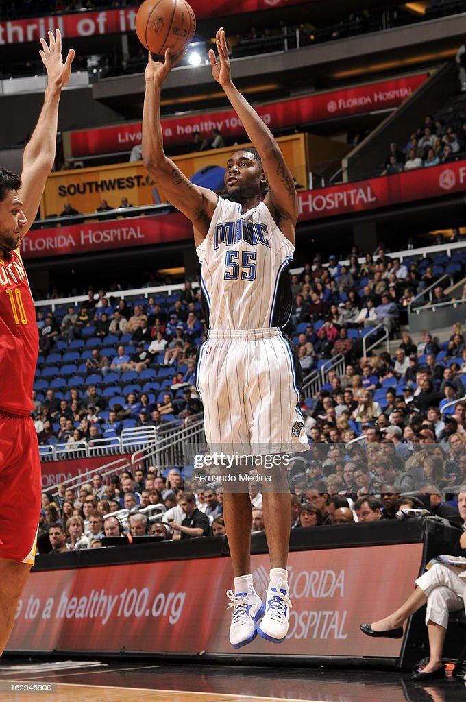 E'Twaun Moore #55 of the Orlando Magic takes a three pointer against Carlos Delfino #10 of the Houston Rockets during the game on March 1, 2013 at Amway Center in Orlando, Florida.