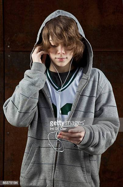Tween boy in listening to mp3 player