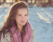 Tween girl in snow