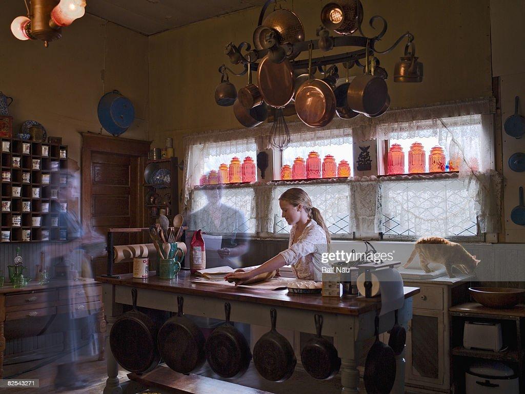Tween girl making dough in kitchen : Stock Photo