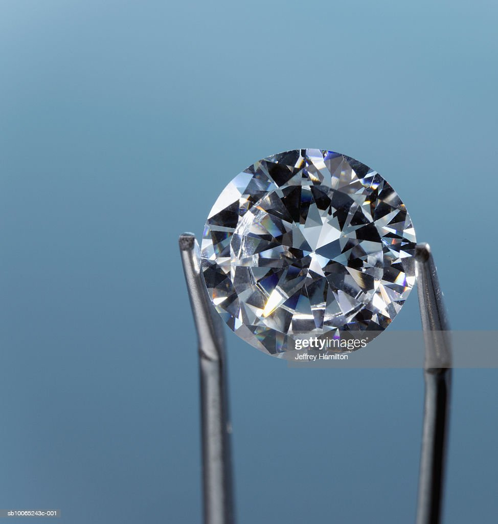 Tweezers holding diamond, close-up