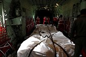 Twelve AirAsia QZ 8501 flight victims' bodies are transferred from Pangkalan Bun to Surabaya with CN235 military aircraft on January 03 2015 Thirty...
