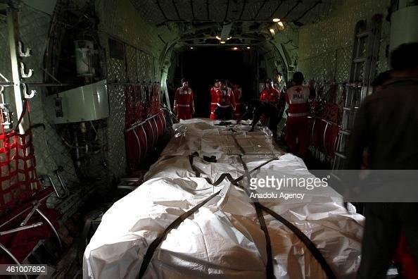 Twelve AirAsia QZ 8501 flight victims' bodies are transferred from Pangkalan Bun to Surabaya with CN235 military aircraft on January 03 2015 Thirty...