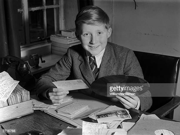 Twelve year old David Dimbleby son of BBC commentator Richard with a requested record for the 'Family Favourites' radio programme that he will...