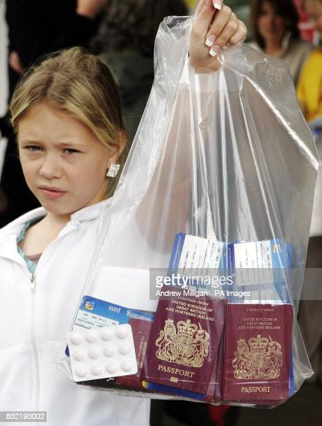 Twelve year old Holly Kennedy with her passport in a bag at Glasgow Airport after a 'very significant' terrorist plot to blow up aircraft in midair...