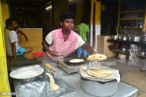 Twelve yearold Indian boy Vikram baked Roti at a roadside hotel on World Day Against Child Labour in Dimapur India northeastern state of Nagaland on...