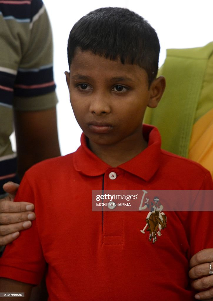 Twelve-year old boy, Sonu looks on after meeting Indian External Affairs Minister Sushma Swaraj at the Ministry of External Affairs in New Delhi on June 30, 2016 Sonu, a 12-year-old Indian boy who was kidnapped from New Delhi and taken to neigbouring Bangladesh six years ago, finally returned home on June 30 to be reunited with his parents. / AFP / MONEY