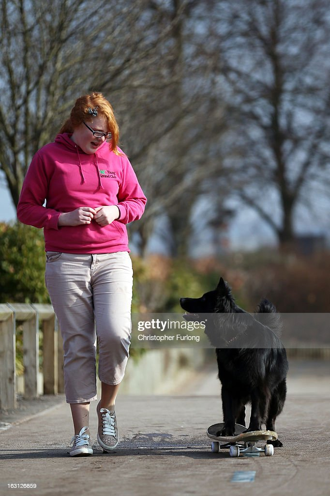 Twelve-year-old Abbie Reynolds Dobson and her dog Marley, a cross German Shepherd/Border Collie, pose for photographers as they practice their heel to music skateboard routine during a photocall to launch Crufts 2013 on March 5, 2013 in Birmingham, England. During this year's four-day competition over 22,000 dogs and their owners will vie for a variety of accolades but ultimately seeking the coveted 'Best In Show'.