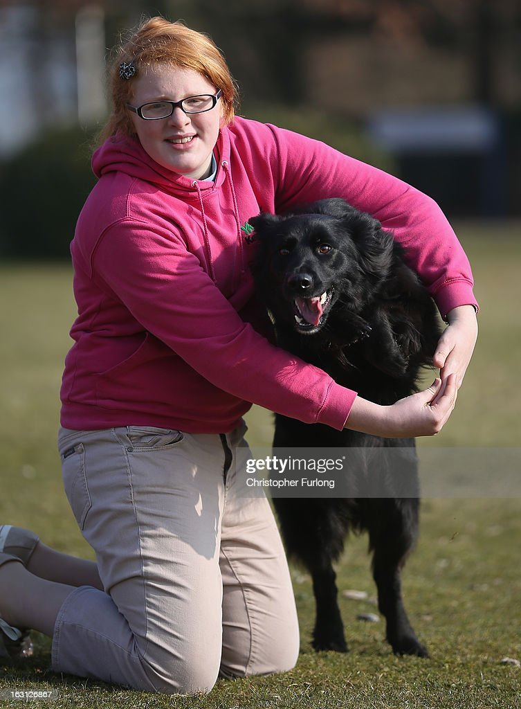 Twelve-year-old Abbie Reynolds Dobson and her dog Marley, a cross German Shepherd/Border Collie, pose for photographers as they practice their heel to music routine during a photocall to launch Crufts 2013 on March 5, 2013 in Birmingham, England. During this year's four-day competition over 22,000 dogs and their owners will vie for a variety of accolades but ultimately seeking the coveted 'Best In Show'.