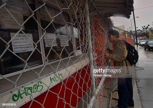 Twelve–year–old Alex Garcia looks through a fence at the legendary Jay's Jayburger stand Thursday afternoon in Hollywood Owner JayAnn Rodgers–Rojas...