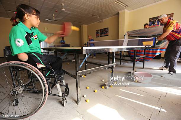 Twelveyearold disabled Iraqi Nejla Imad plays table tennis in Baquba a city northeast of Baghdad on February 20 2016 Imad like tens of thousands of...
