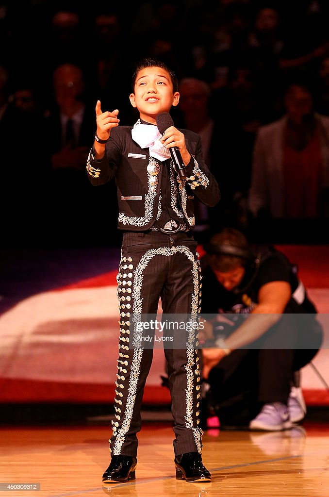 Twelve-year-old Sebastien De La Cruz performs the national anthem prior to Game Two of the 2014 NBA Finals between the San Antonio Spurs and the Miami Heat at the AT&T Center on June 8, 2014 in San Antonio, Texas.