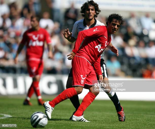 FC Twente's Kenneth Perez under pressure from Swansea's Guillem Bauza during the Preseason Friendly match at The Liberty Stadium Swansea