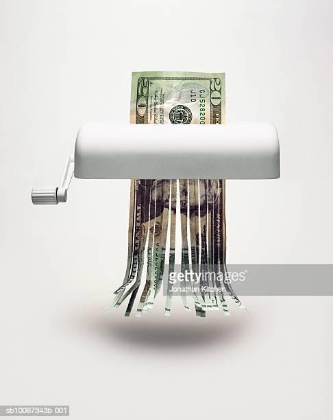Twenty dollar bill in shredder