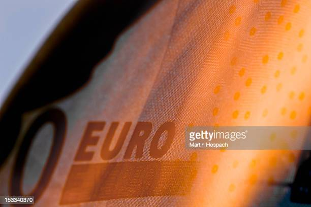 A twenty euro banknote on fire, extreme close up
