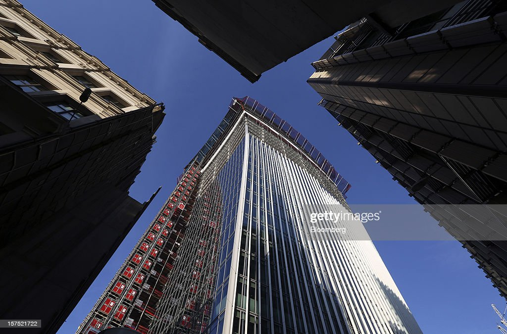 Twenty Fenchurch Street, also know as the 'Walkie-Talkie,' building, centre, stands during construction in the financial district in London, U.K., on Friday, Nov. 30, 2012. U.K. banks have become more unwilling to finance development projects without a tenant committed to lease space or a buyer for the completed property. Photographer: Chris Ratcliffe/Bloomberg via Getty Images
