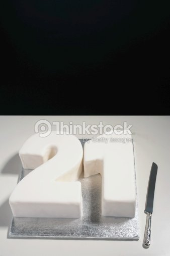 Twenty First Birthday Cake On Table By Silver Knife Stock Photo