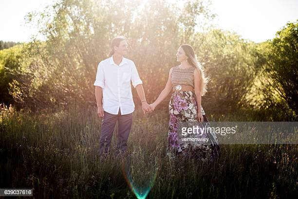 Twenty year olds hold hands during engagment