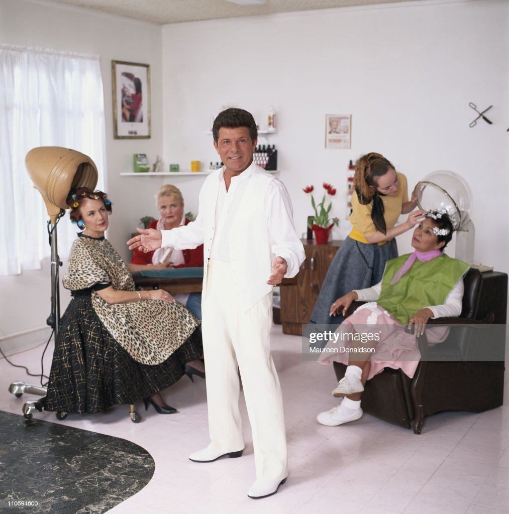 Twenty years on, American singer and actor Frankie Avalon recreates his 'Beauty School Dropout' segment from the 1978 musical film 'Grease'. A photoshoot for People Magazine - pub. 13th April 1998.