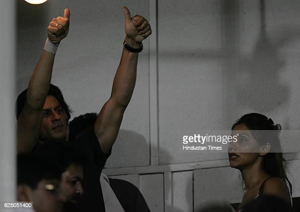 SRK Twenty20 Cricket India vs Australia Shahrukh Khan with his wife Gauri Khan and actress Deepika Padukone during the first T20 match between India...