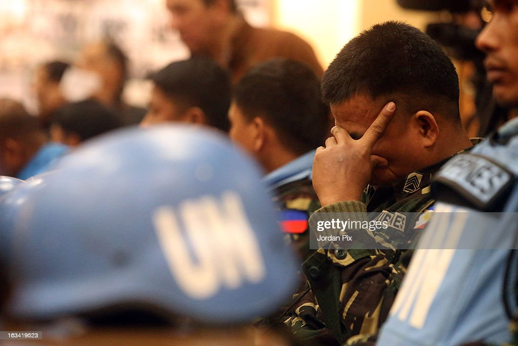 Twenty-one Filipino UN peacekeepers who were held hostage at the free Syrian army in Golan arrive in Amman after crossing into Jordan from Syria on March 9, 2013 in Amman, Jordan. The hostages were received by the Jordanian Foreign minister Nasser Joudah, Minister of Information Samih Maaytah and the Chief of Staff Mishaal al Zaben.