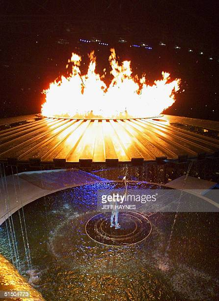 Twentyseven year old sporting icon Cathy Freeman Australia's gold medal hope over 400m and 200m as the final bearer of the Olympic torch appears...