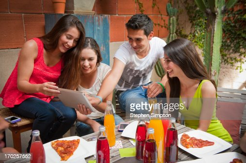 twenty-somethings [students] having a patio party : Stock Photo