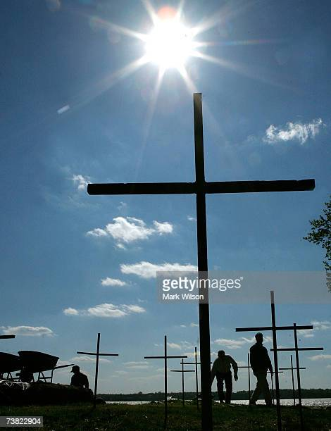 Twentytwo crosses mark spots where archaeologists with the Association for the Preservation of Virginia Antiquities found human remains dating back...