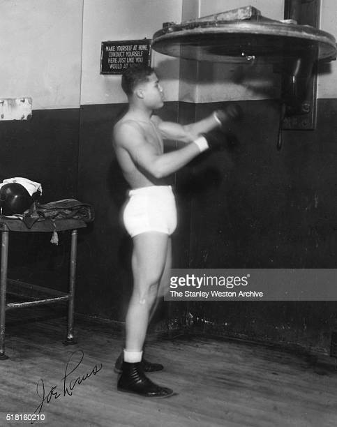 Twentyyearold Joe Louis Sharpens his timing on a speed bag at a Detroit gym one week before his scheduled professional debut on June 27 1934 in...