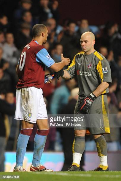 Twice goalscorer John Carew Aston Villa shakes hands with Reading's goalkeeper Marcus Hahnemann after the final whistle