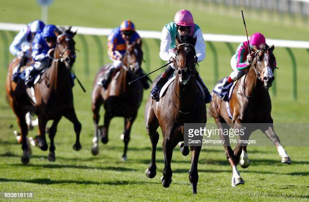 Twice Over ridden by Richard Hughes wins the Voute Sales Maiden Stakes at Newmarket Racecourse Suffolk