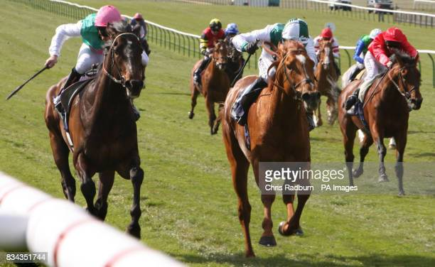 Twice Over ridden by Ted Durcan [left] wins the The Banshahousestablescom Craven Stakesahead of Ravens Pass ridden by Jimmy Fortune at Newmarket...
