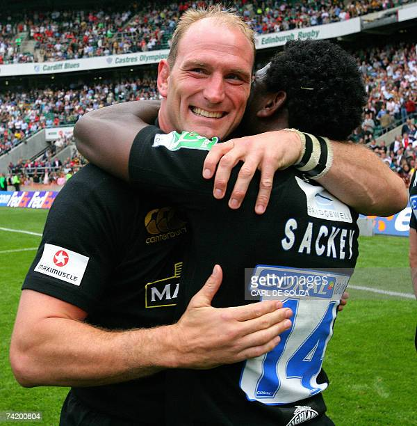 London Wasps no 8 Lawrence Dallaglio embraces right wing Paul Sackey after their team beat the Leicester Tigers in Heineken Cup final at Twickenham...