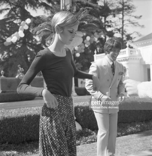 Twiggy is the guest of honor at a party held at the house of Sonny and Cher LR Twiggy and Justin de Villeneuve on May 15 1967 in Beverly Hills...
