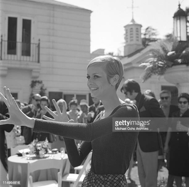 Twiggy is the guest of honor at a party held at the house of Sonny and Cher on May 15 1967 in Beverly Hills California