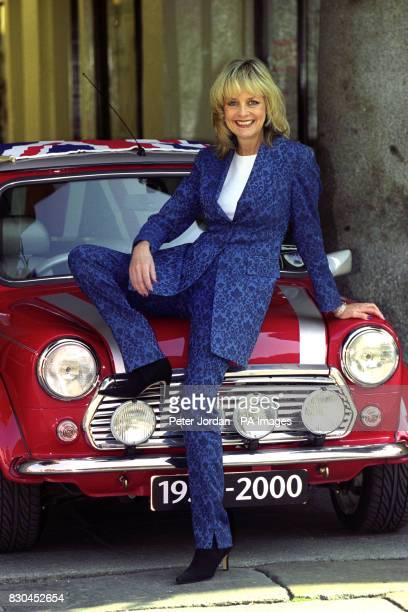 Twiggy the supermodel of the Swinging Sixties pictured with another British style icon the Mini Classic car in Covent Garden London as it enters its...