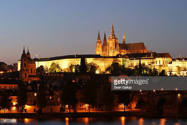 Twilight descends upon Prague Castle also called Hradcany Castle October 28 2003 in Prague Czech Republic Prague Castle which also contains the Czech...