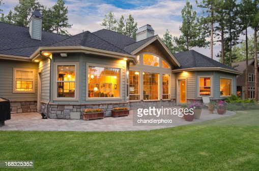 Twilight exterior of home and landscape