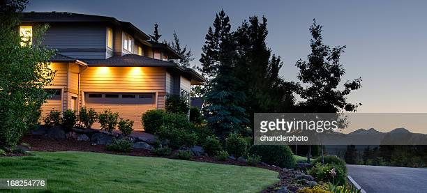 Twilight exterior of home and lawn