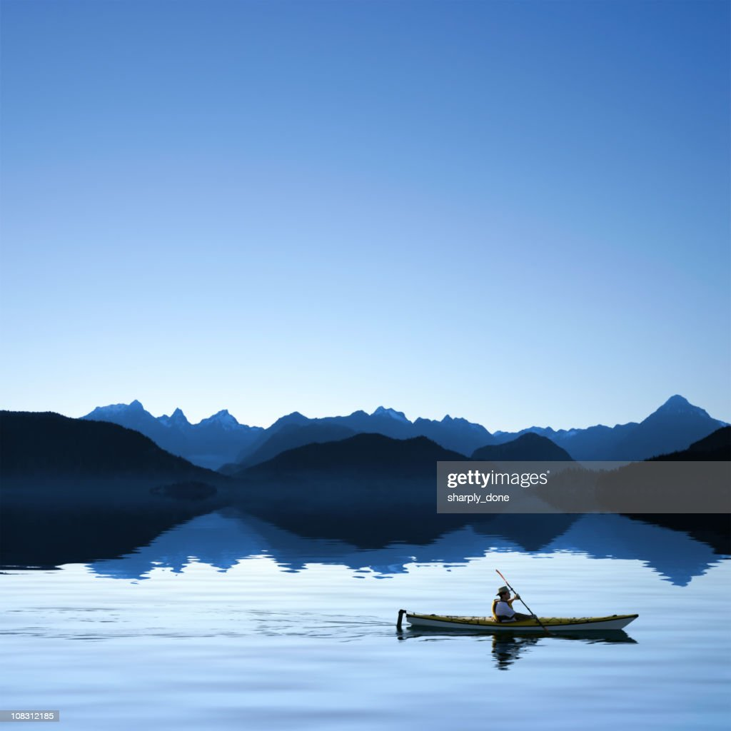 twilight ocean kayaking : Stock Photo