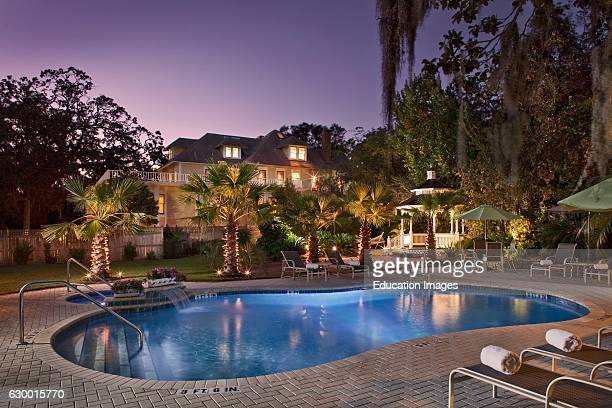 Twilight shot of backyard pool at an Amelia Island Inn Hoyt House Amelia Island FL
