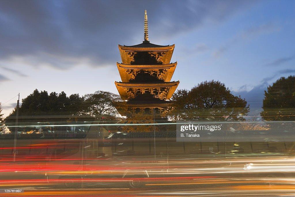 Twilight Traffic and Pagoda at Kyoto's Toji Temple : Stock Photo