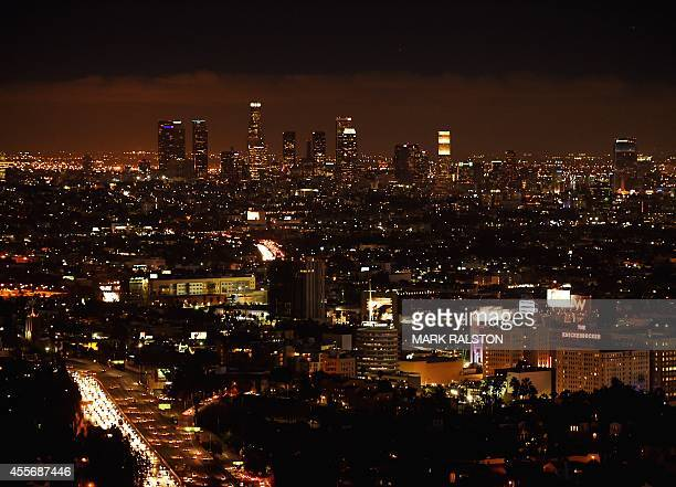 Twilight view of the downtown district of Los Angeles city taken from the Hollywood Hills on September 18 2014 AFP PHOTO/Mark RALSTON