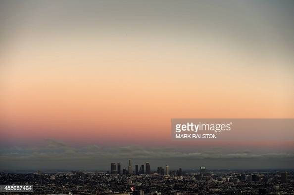 Twilight view of the downtown district of Los Angeles taken from the Hollywood Hills on September 18 2014 AFP PHOTO/Mark RALSTON
