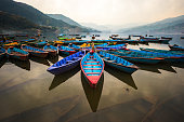 twilight with boats on Phewa lake, Pokhara, Nepal
