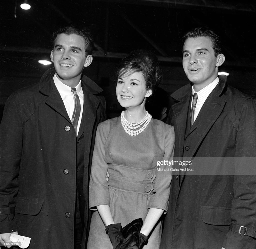 Twin actors Dirk and Dack Rambo pose with Shelley Fabares during an event in Los AngelesCA