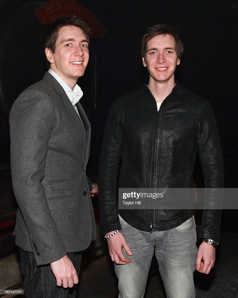 Twin actors <a gi-track='captionPersonalityLinkClicked' href=/galleries/search?phrase=Oliver+Phelps&family=editorial&specificpeople=810288 ng-click='$event.stopPropagation()'>Oliver Phelps</a> and Jamie Phelps pose in front of the Hogwarts Express at Harry Potter:The Exhibition at Discovery Times Square on February 19, 2013 in New York City.