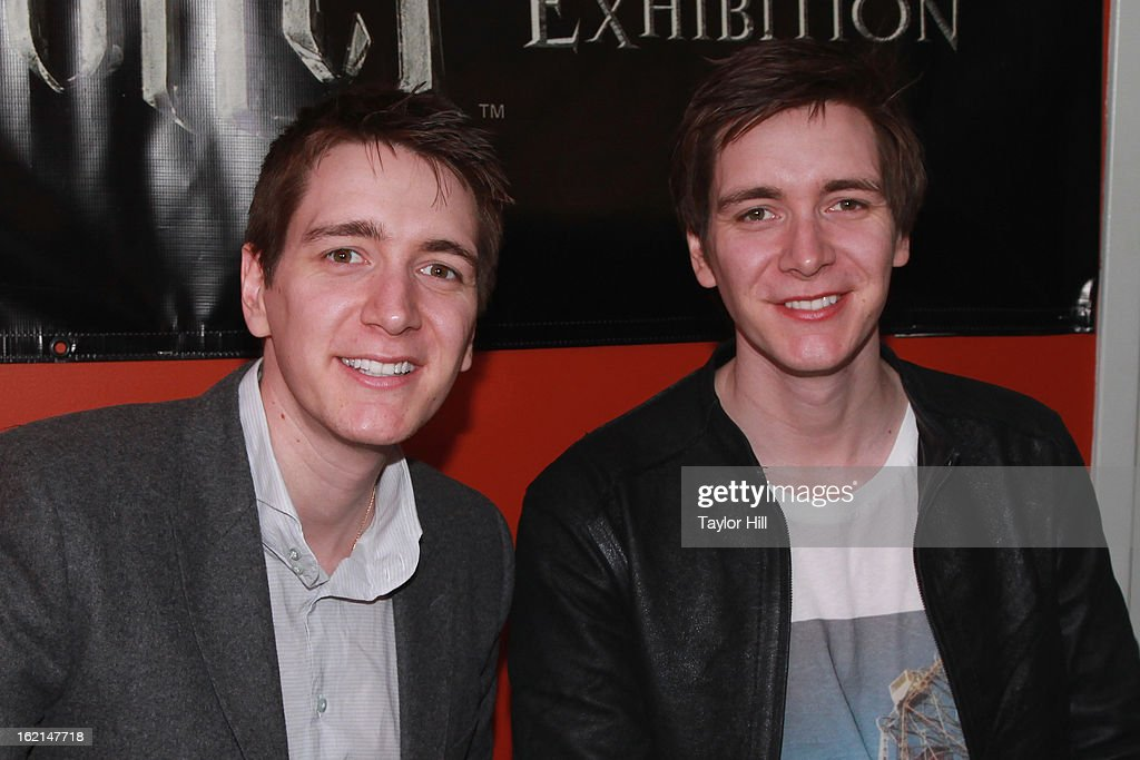 Twin actors <a gi-track='captionPersonalityLinkClicked' href=/galleries/search?phrase=Oliver+Phelps&family=editorial&specificpeople=810288 ng-click='$event.stopPropagation()'>Oliver Phelps</a> and Jamie Phelps pose together at Harry Potter: The Exhibition at Discovery Times Square on February 19, 2013 in New York City.